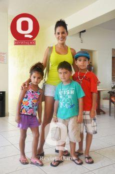 Gina Ramírez y sus hijos